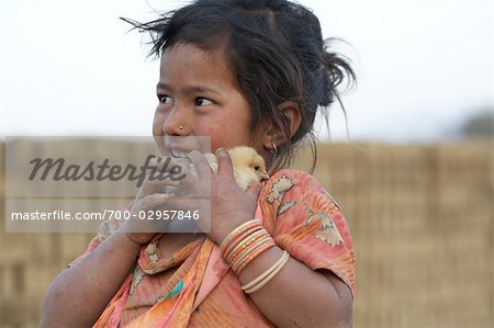 Little Girl Holding Chick, Chapagaon, Nepal Stock Photo - Rights-Managed, Image code: 700-02957846
