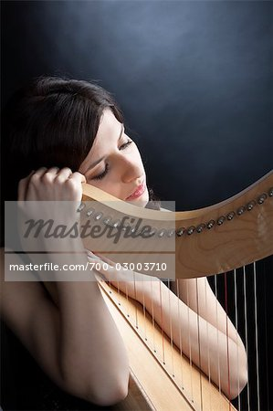 Woman Posing with Harp Stock Photo - Rights-Managed, Image code: 700-03003710