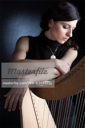 Woman with Harp, Rome, Italy Stock Photo - Rights-Managed, Image code: 700-03003711