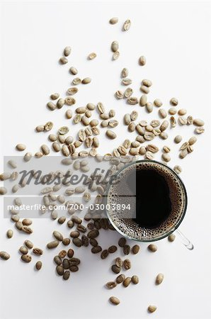 Cup of Coffee Surrounded by Coffee Beans Stock Photo - Rights-Managed, Image code: 700-03003894