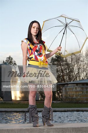 Woman Holding Umbrella near Water Fountain Stock Photo - Rights-Managed, Image code: 700-03004260