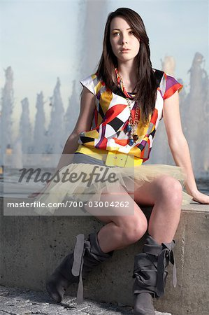 Woman Sitting by Edge of Water Fountain Stock Photo - Rights-Managed, Image code: 700-03004262
