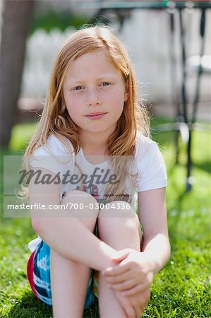Portrait of Girl Sitting on Lawn