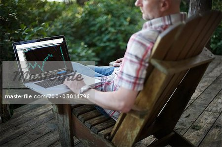 Man Using a Laptop Computer at the Cottage Stock Photo - Rights-Managed, Image code: 700-03014796