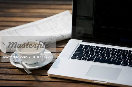 Laptop Computer, Newspaper and a Cup of Coffee Stock Photo - Rights-Managed, Image code: 700-03014799