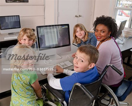 Teacher with Students at Computer Stock Photo - Rights-Managed, Image code: 700-03017555
