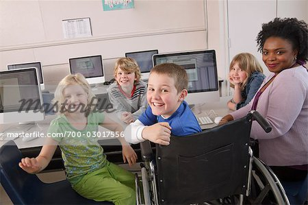 Teacher with Students at Computer Stock Photo - Rights-Managed, Image code: 700-03017556