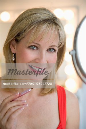 Woman Applying Make-up Stock Photo - Rights-Managed, Image code: 700-03017728