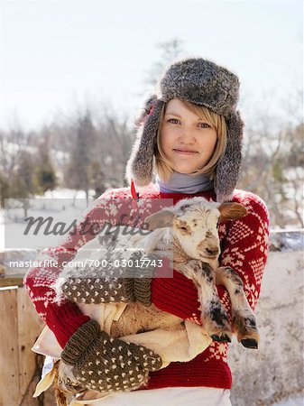 Woman Holding Newborn Lamb Stock Photo - Rights-Managed, Image code: 700-03017743