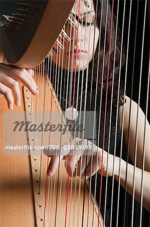 Woman Playing the Harp Stock Photo - Rights-Managed, Image code: 700-03059198