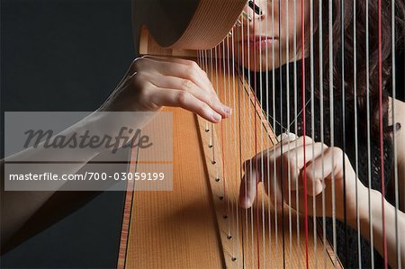 Woman Playing the Harp Stock Photo - Rights-Managed, Image code: 700-03059199