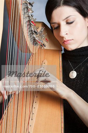 Woman Playing the Harp Stock Photo - Rights-Managed, Image code: 700-03059200