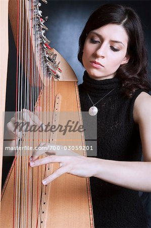 Woman Playing the Harp Stock Photo - Rights-Managed, Image code: 700-03059201
