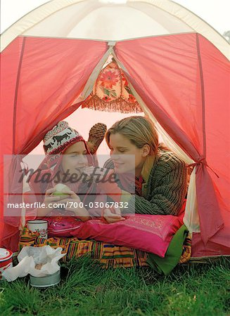 Mother and Daughter Eating inside Tent Stock Photo - Rights-Managed, Image code: 700-03067832