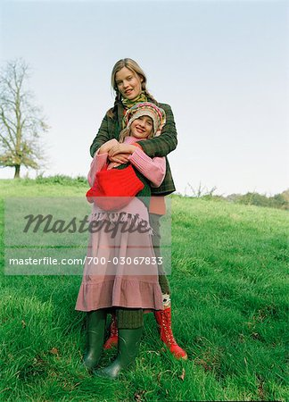 Portrait of Mother and Daughter Standing in Field Stock Photo - Rights-Managed, Image code: 700-03067833