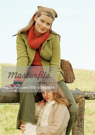 Mother and Daughter by Fence Stock Photo - Rights-Managed, Image code: 700-03067834