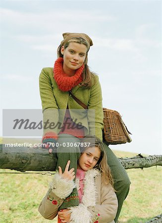 Mother and Daughter by Fence Stock Photo - Rights-Managed, Image code: 700-03067837