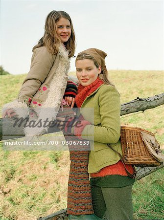 Mother and Daughter by Fence Stock Photo - Rights-Managed, Image code: 700-03067839