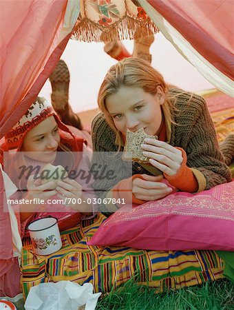 Mother and Daughter Cuddling inside Tent Stock Photo - Rights-Managed, Image code: 700-03067841