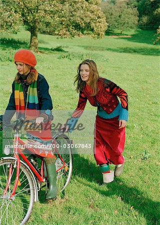 Mother pushing Daughter on Bicycle Stock Photo - Rights-Managed, Image code: 700-03067843