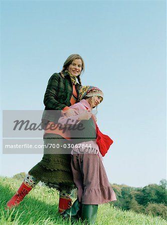 Mother and Daughter Standing in Field Stock Photo - Rights-Managed, Image code: 700-03067844