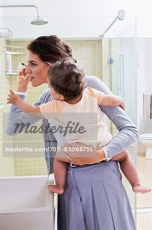 Mother Holding Baby and Applying Make-up Stock Photo - Rights-Managed, Image code: 700-03068735