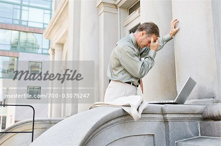 Businessman With Laptop Outdoors Stock Photo - Rights-Managed, Image code: 700-03075247