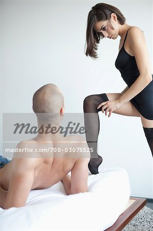 Couple in Bedroom Stock Photo - Rights-Managed, Image code: 700-03075525