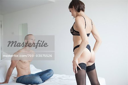 Couple in Bedroom Stock Photo - Rights-Managed, Image code: 700-03075526