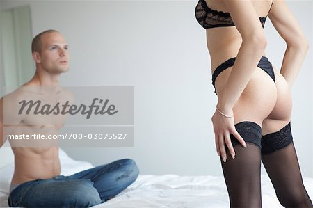 Couple in Bedroom Stock Photo - Rights-Managed, Image code: 700-03075527