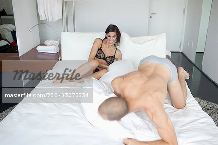 Couple in Bed Stock Photo - Rights-Managed, Image code: 700-03075534