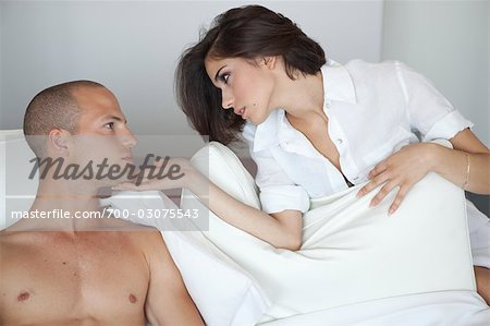 Couple in Bed Stock Photo - Rights-Managed, Image code: 700-03075543