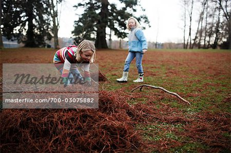 Girls Playing Outdoors Stock Photo - Rights-Managed, Image code: 700-03075882