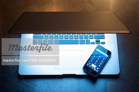 Laptop Computer and iPhone Stock Photo - Rights-Managed, Image code: 700-03152419