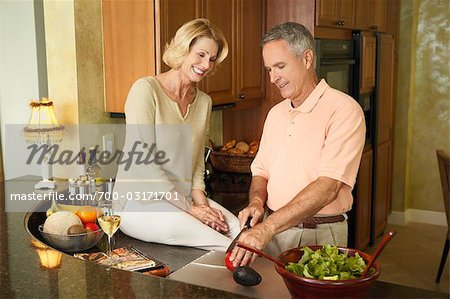 Couple in Kitchen Preparing Dinner Stock Photo - Rights-Managed, Image code: 700-03171701