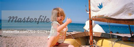 Little Girl Sitting in Old Boat on the Beach, Luc-sur-Mer, Calvados, Normandy, France Stock Photo - Rights-Managed, Image code: 700-03178403