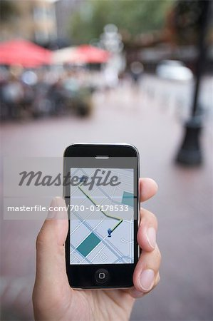 Person Holding GPS Device Stock Photo - Rights-Managed, Image code: 700-03178533