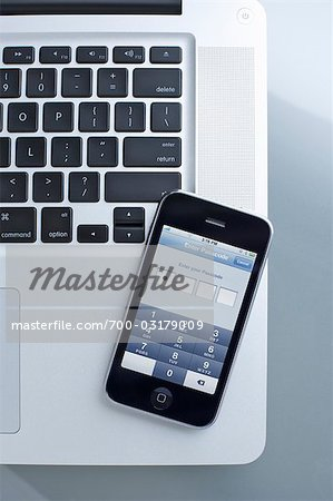 Still Life of iPhone and Laptop Computer Stock Photo - Rights-Managed, Image code: 700-03179009
