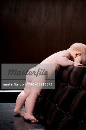 Baby Looking over Back of Sofa Stock Photo - Rights-Managed, Image code: 700-03210573