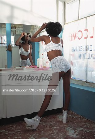 Backview of Woman wearing Lingerie Looking in Mirror Stock Photo - Rights-Managed, Image code: 700-03290126