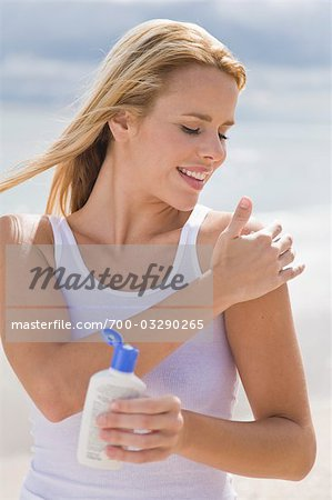Woman Applying Suntan Lotion Stock Photo - Rights-Managed, Image code: 700-03290265