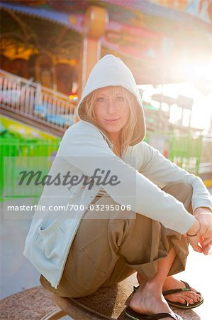 Portrait of Woman Sitting on the Boardwalk in Santa Cruz, California, USA Stock Photo - Rights-Managed, Image code: 700-03295008