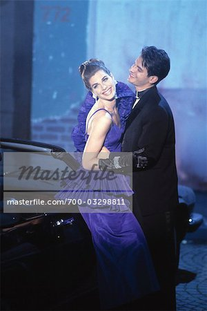 Couple standing by Car wearing Evening Clothes Stock Photo - Rights-Managed, Image code: 700-03298811