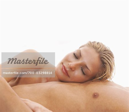 Woman Lying on Man's Chest Stock Photo - Rights-Managed, Image code: 700-03298814