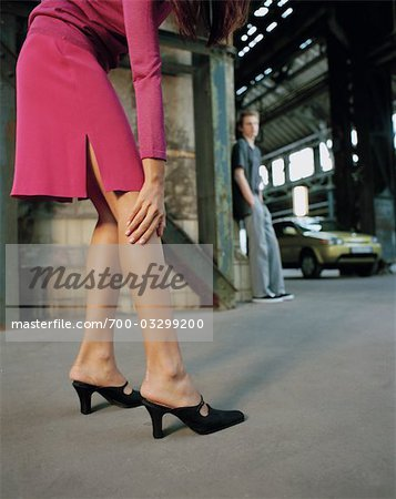 Woman in High Heels, Man in the Background Stock Photo - Rights-Managed, Image code: 700-03299200