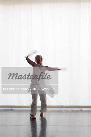 Woman Dancing in Front of a White Curtain, Salzburg, Salzburger Land, Austria Stock Photo - Rights-Managed, Image code: 700-03299223