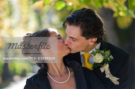 Bride and Groom Kissing, Salzburg, Salzburger Land, Austria Stock Photo - Rights-Managed, Image code: 700-03299229