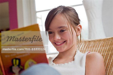 Teenage Girl Reading Book Stock Photo - Rights-Managed, Image code: 700-03333124