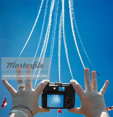Women's Hands Holding Digital Camera, Taking Picture of Snowbirds at Air Show, CNE, Toronto, Ontario, Canada Stock Photo - Rights-Managed, Image code: 700-03403781