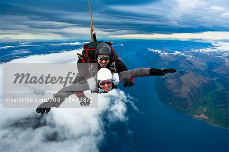 Tandem Sky Diving over The Remarkables in Queenstown, South Island, New Zealand Stock Photo - Rights-Managed, Image code: 700-03403872